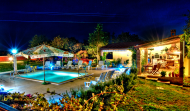 Tropicana Pool and Summer Kitchen by Night